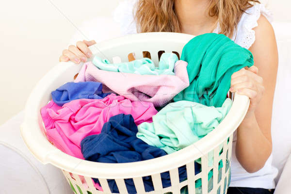 2320421 stock photo close up of a caucasian woman doing laundry